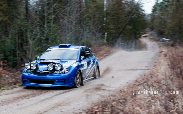 Wallpaper of Pat Richard's Subaru WRX STI landing after a jump.