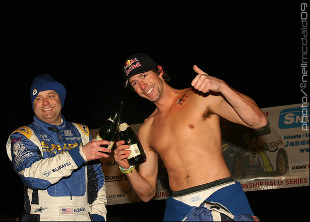Travis showing off his latest scar... And celebrating vistory with his co-driver, Cristian Edstrom - ©Neil McDaid