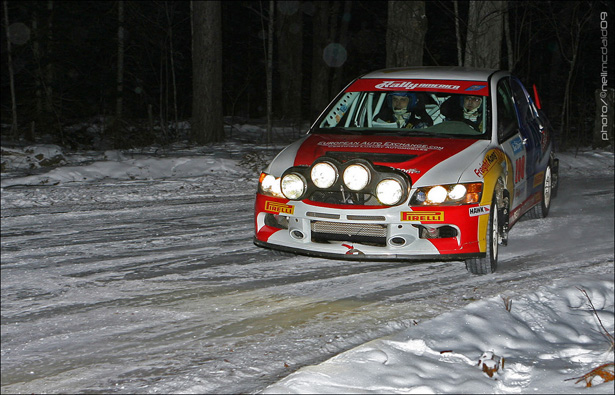 Gruszka's EVO IX with rally-lights at a night stage - ©Neil McDaid