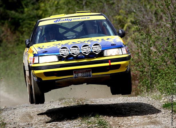 Old school Subaru Legacy Turbo launching off a jump - ©Neil McDaid